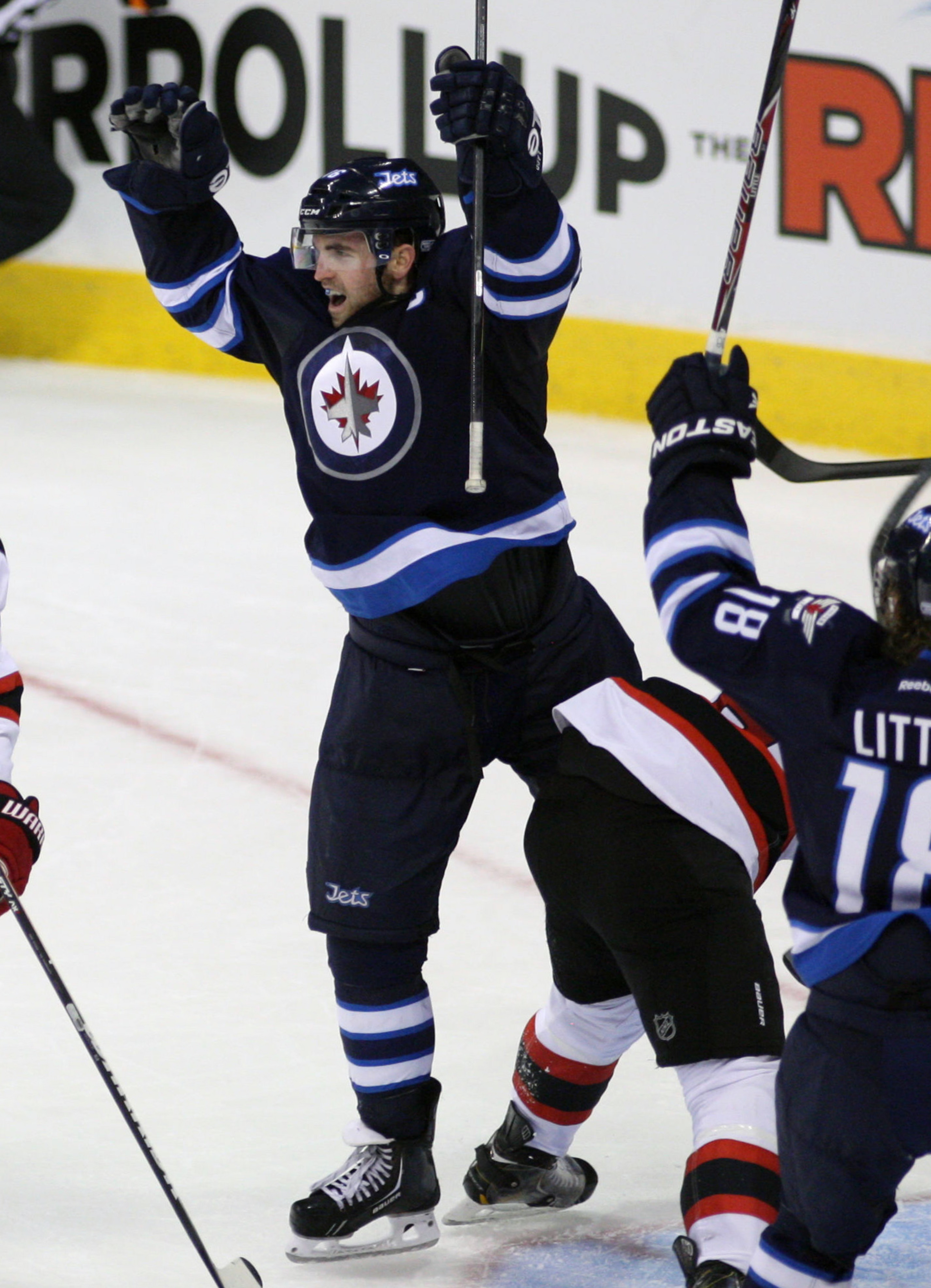 Winnipeg Captain Andrew Ladd celebrates his goal in New Jersey Thursday and a big contributor to the Jets recent 3-game winning streak.
